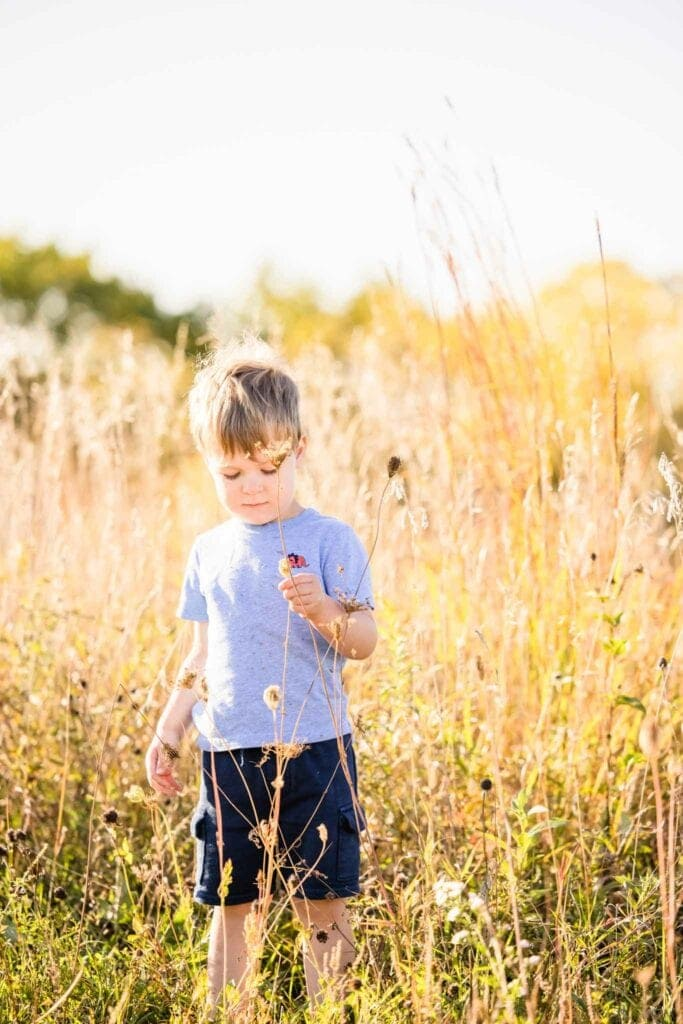 Child playing in grass La Crosse WI