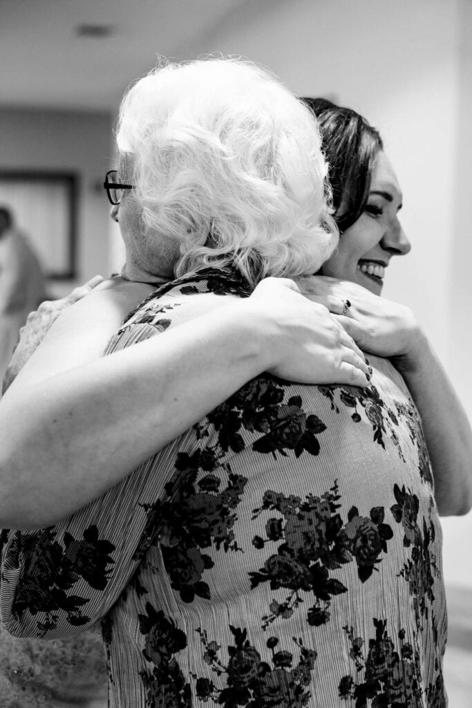 Hugging grandma at wedding by La Crosse, WI Photographer Jeff Wiswell