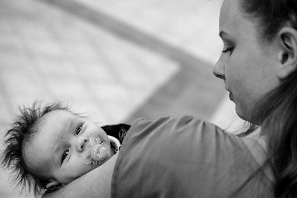 Baby at wedding by La Crosse, WI Photographer Jeff Wiswell