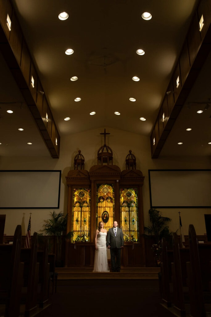 Couple at altar by La Crosse, WI Photographer Jeff Wiswell