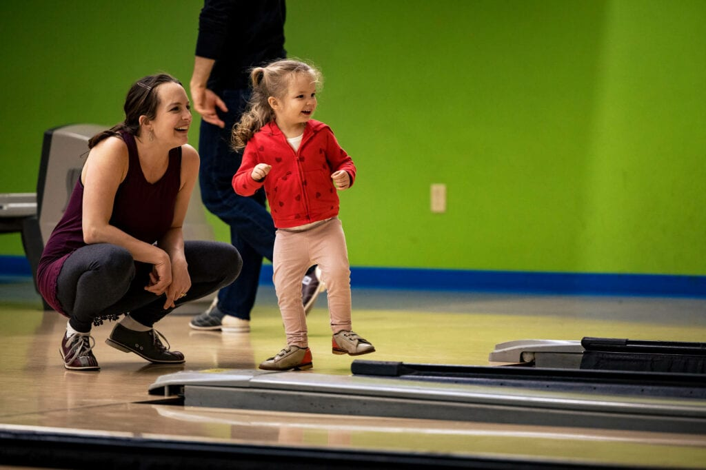 Girl bowling by La Crosse, WI Photographer Jeff Wiswell