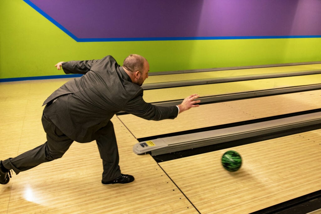 Groom bowling by La Crosse, WI Photographer Jeff Wiswell