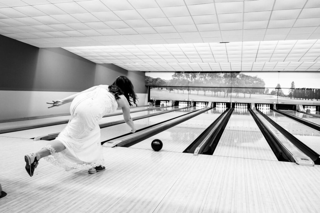 Bride bowling by La Crosse, WI Photographer Jeff Wiswell