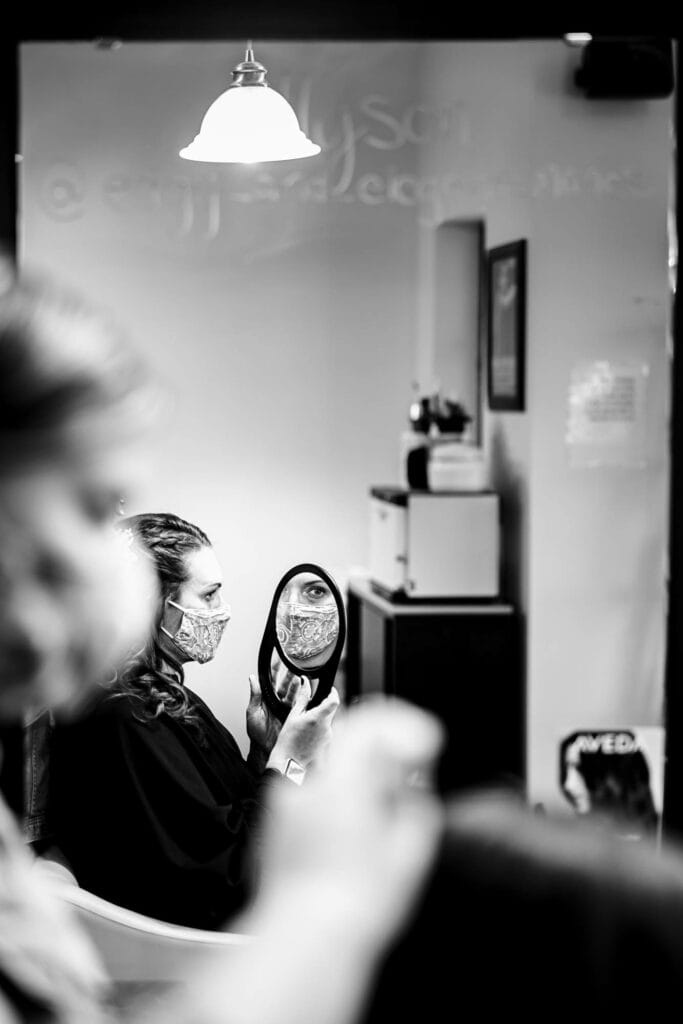 Mirror while styling hair by La Crosse, WI Photographer Jeff Wiswell