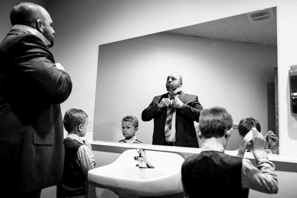 Learning how to tie a tie by La Crosse, WI Photographer Jeff Wiswell