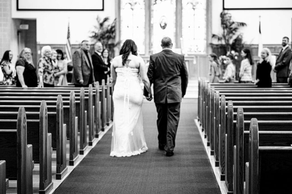 Bride walking down the aisle by La Crosse, WI Photographer Jeff Wiswell