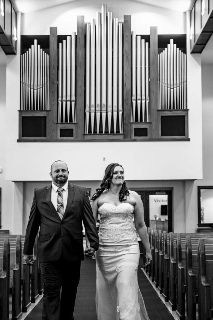 Couple walking down the aisle by La Crosse, WI Photographer Jeff Wiswell