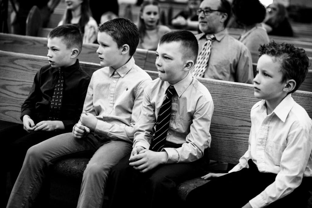 Boys watching a wedding by La Crosse, WI Photographer Jeff Wiswell