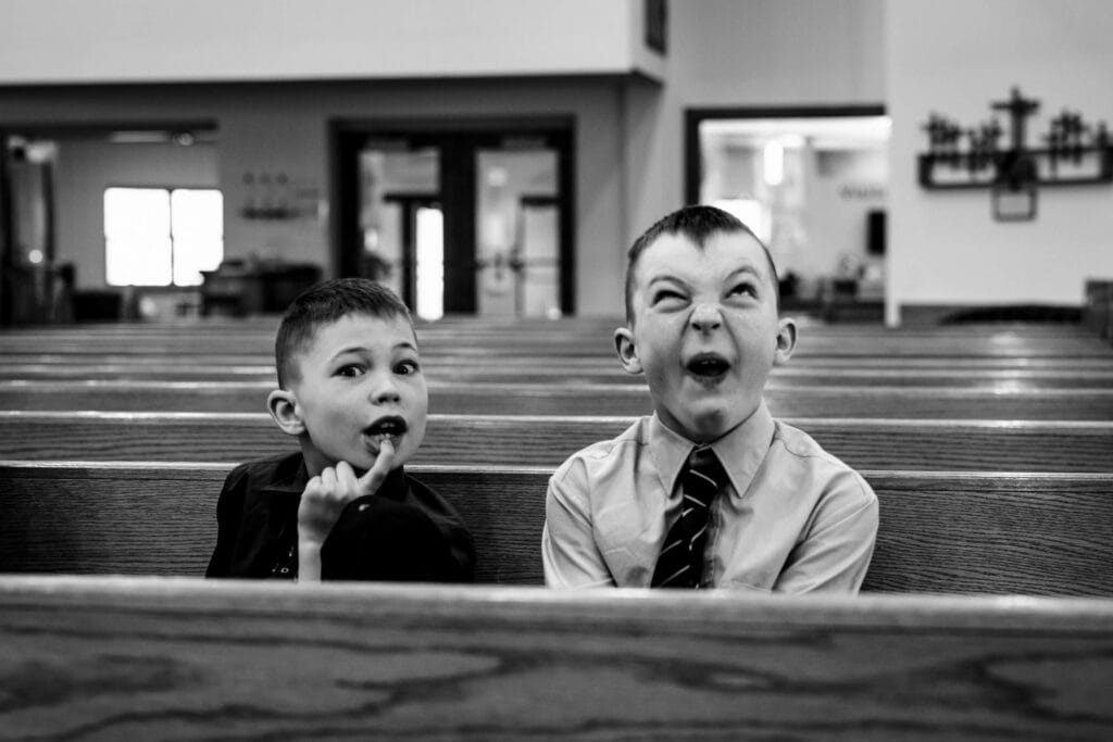 Funny kid at wedding by La Crosse, WI Photographer Jeff Wiswell