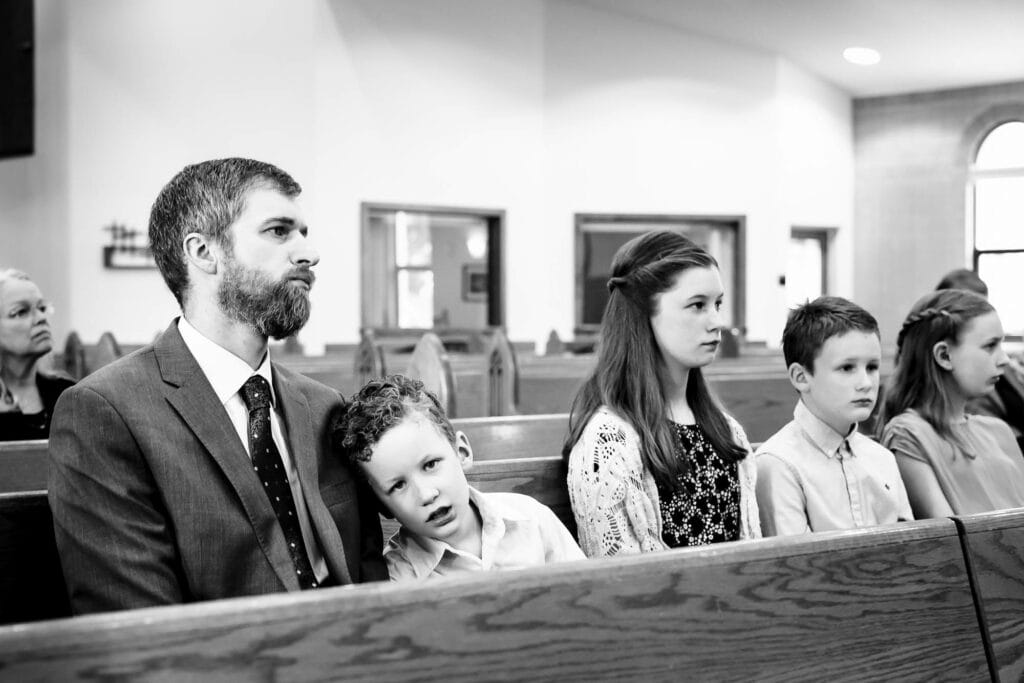 Bored kid at wedding by La Crosse, WI Photographer Jeff Wiswell