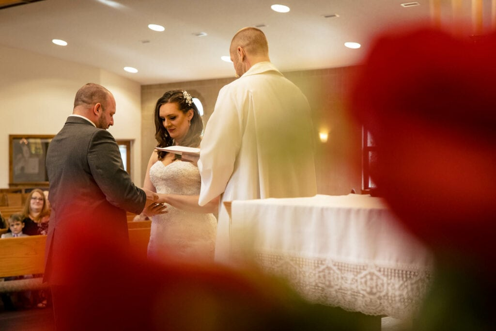 Couple at the altar by La Crosse, WI Photographer Jeff Wiswell