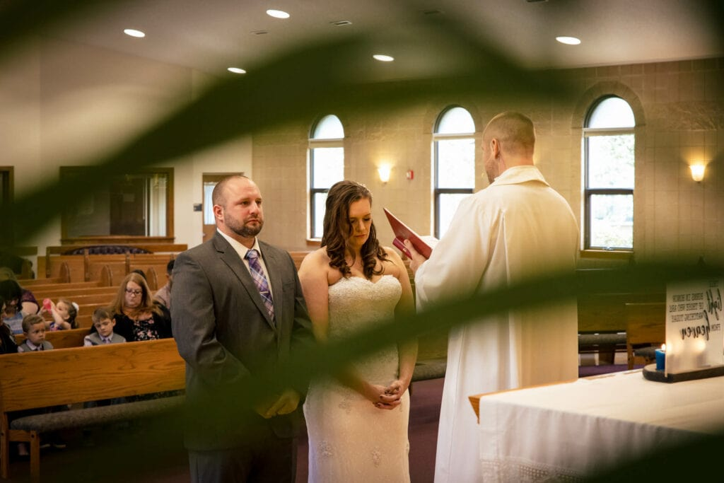 Couple in prayer by La Crosse, WI Photographer Jeff Wiswell